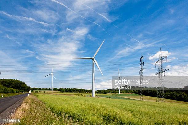 Germany, Bavaria, View of wind turbine and electricity pylon
