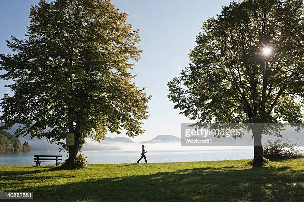 Germany, Bavaria, Walchensee, Senior woman walking