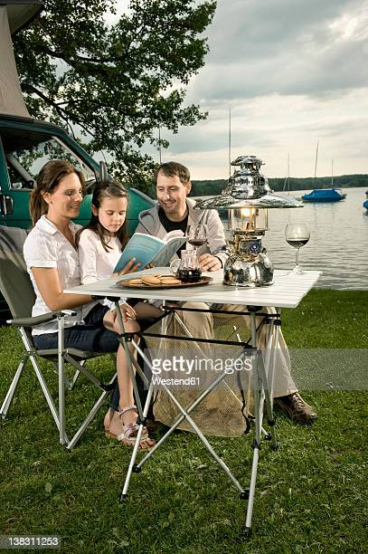 Germany, Bavaria, Woerthsee, Family on camp near lakeshore