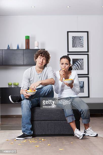 Germany, Bavaria, Young couple watching TV