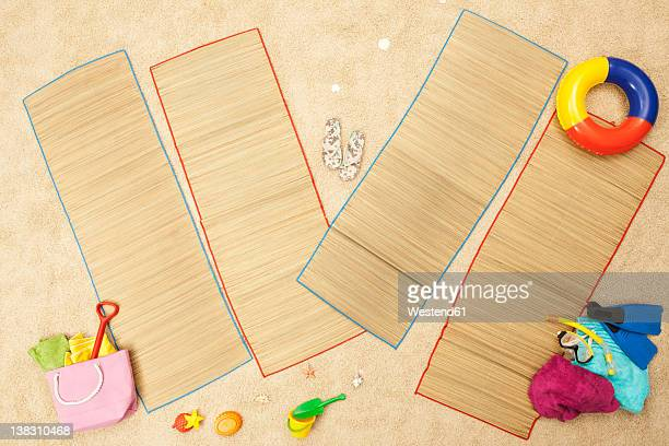 Germany, Beach toys and mat on artificial beach scene