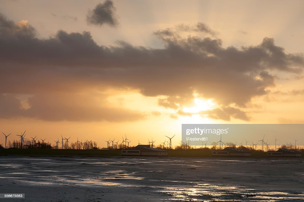 Germany, Bensersiel, coastal landscape with wind turbines at sunset