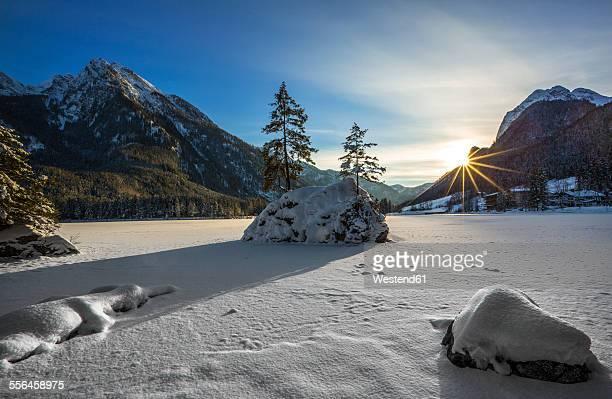 Germany, Berchtesgadener Land, Ramsau, Lake Hintersee at sunset in winter