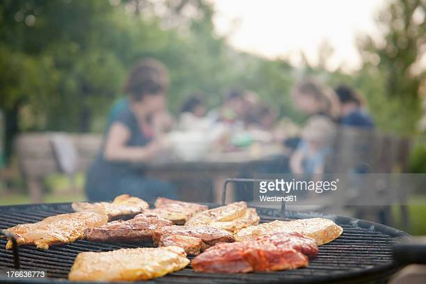 Germany, Berlin, Barbecue grill in garden