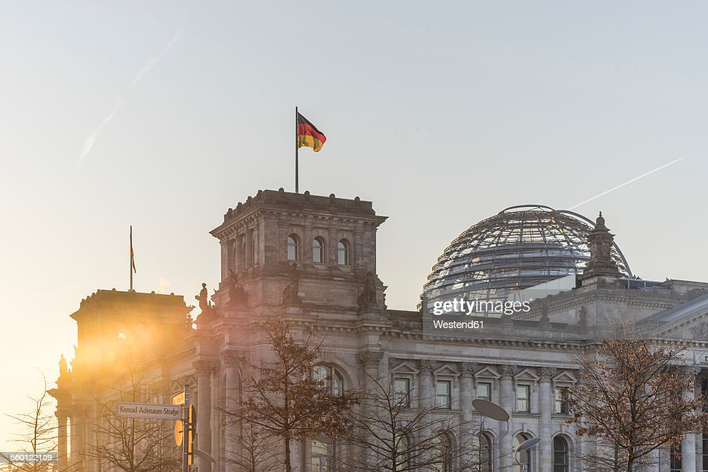Germany, Berlin, Berlin-Tiergarten, Reichstag building against the sun in the morning