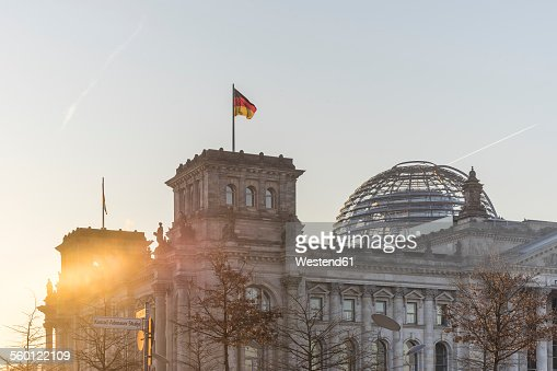 Germany, Berlin, Berlin-Tiergarten, Reichstag building against the sun in the morning