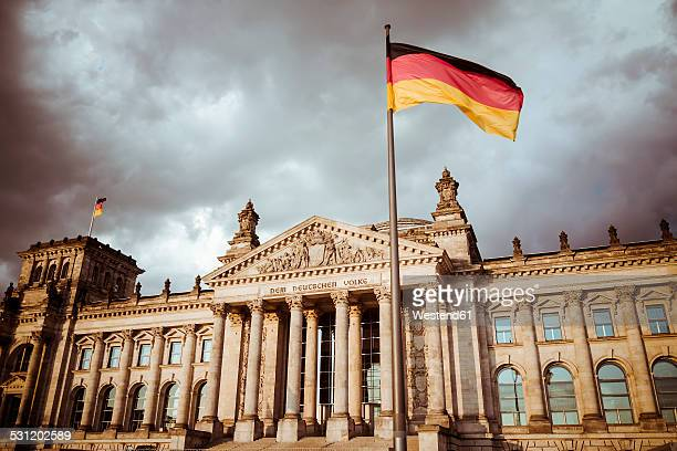 Germany, Berlin, Berlin-Tiergarten, Reichstag building and German flag