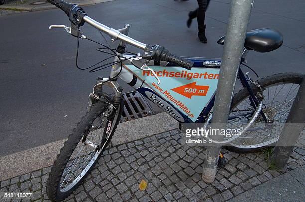 Germany Berlin bicycle with advertising for the highwire adventure course Mount Mitte
