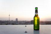 Germany, Berlin, Bottle of beer on balustrade