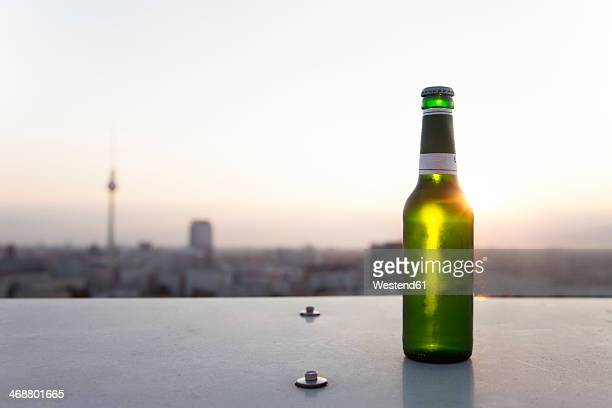 Germany, Berlin, Bottle of beer on balustrade