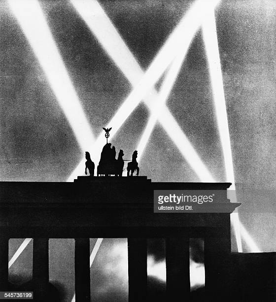Germany Berlin Brandenburg Gate and spotlights of flaks during WW II 1944
