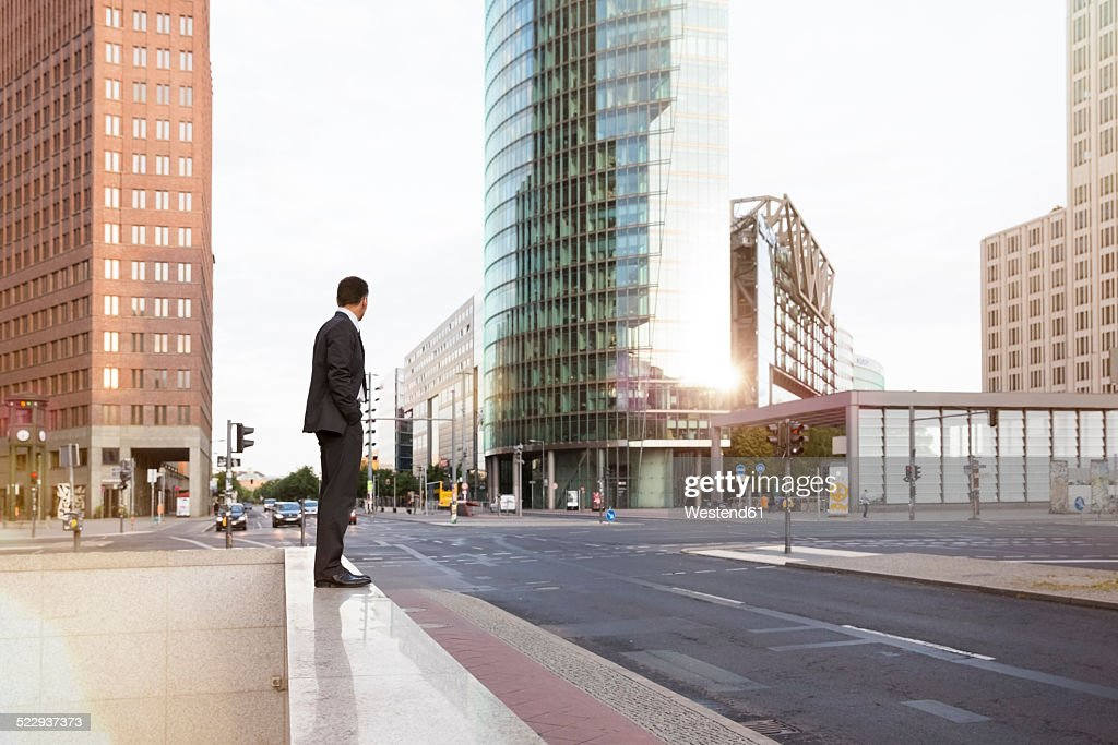Germany, Berlin, Businessman standing on balustrade