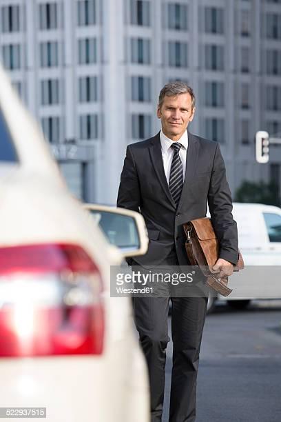 Germany, Berlin, Businessman taking a taxi