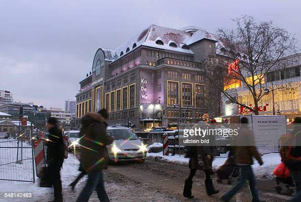 Germany Berlin Charlottenburg pedestrians are crossing the snowed in road Tauentzienstrasse in the background the department store Kaufhaus des...