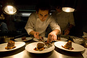 Germany, Berlin, chefs preparing meals