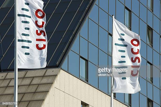 flags with the US 'Cisco' company logo in front of Hotel Estrel Convention Center