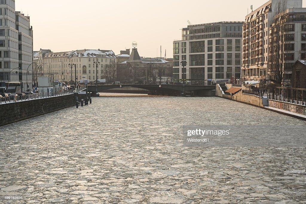 Germany, Berlin, frozen Spree river, view to Berliner Ensemble theatre
