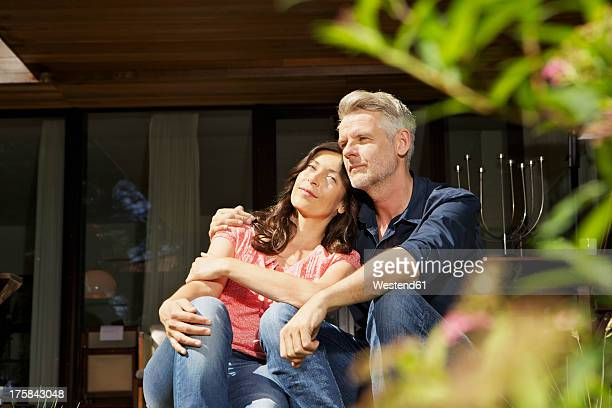 Germany, Berlin, Mature couple relaxing on terrace