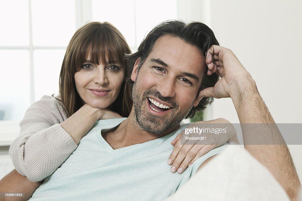 Germany, Berlin, Mature couple smiling, portrait