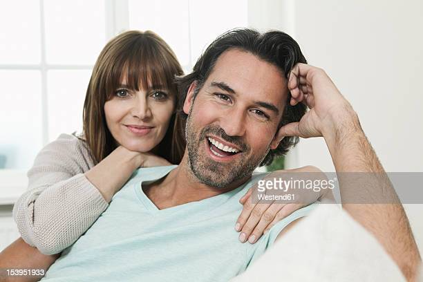 Germany, Berlin, Mature couple smiling, portrait