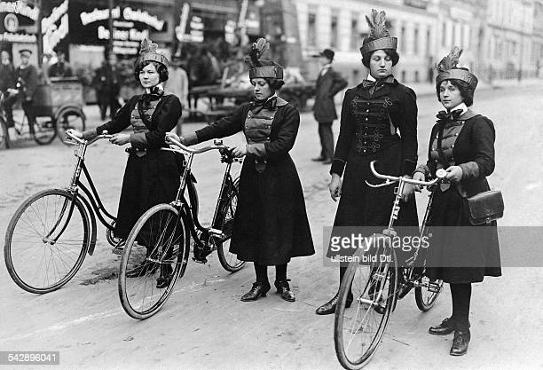 Germany Berlin messenger girls in uniform with their bikes date unknown around 1910 photo by E Hohlwein