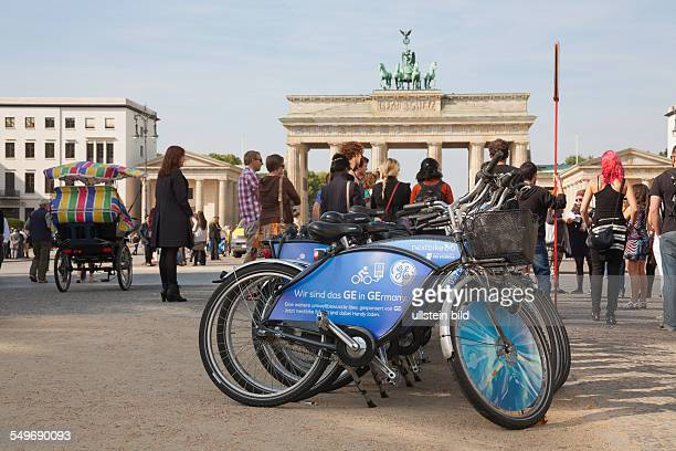 bicycle for rent from 'nextbike' with advertisement from 'General Electric' in front of the Brandenburg Gate 'Brandenburger Tor'