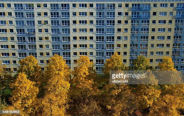 Germany Berlin Mitte building made with precast concrete slabs in front colourful trees in autumn