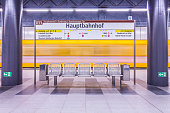 Germany, Berlin, modern architecture of subway station Hauptbahnhof, central station, with moving underground train