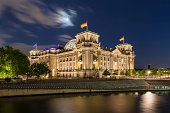 Germany, Berlin, Reichstag dome near River spree at night