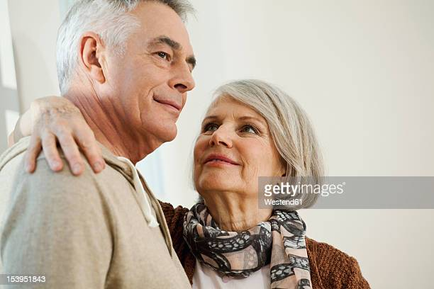 Germany, Berlin, Senior couple smiling