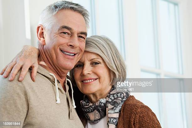 Germany, Berlin, Senior couple smiling, portrait