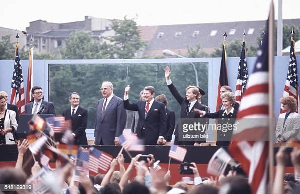Germany Berlin Tiergarten American President Ronald Reagan during his address in front of the Brandenburg Gate from left Philipp Jenninger Helmut...