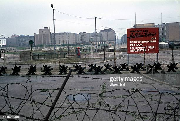 Germany Berlin Tiergarten Berlin Wall at Potsdamer Platz with a poster 'Off the Hallstein Doktin ' um 1965
