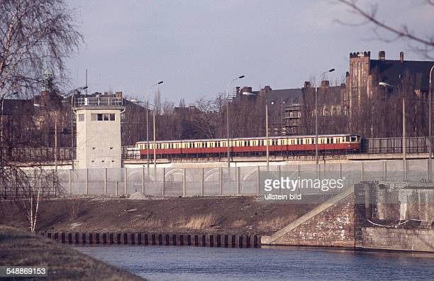 Germany Berlin Tiergarten Berlin wall at the Spree river bank in the background the Government Hospital of the GDR Invalidenstrasse