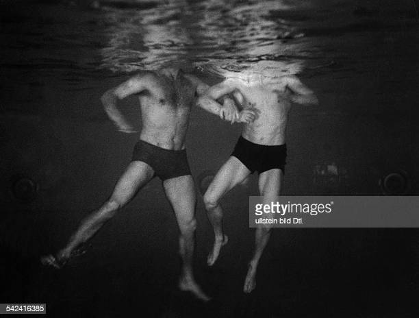 Germany Berlin training of highperformance sportsmen in the German Reich picture of two swimmers under water taken through the submarine observation...