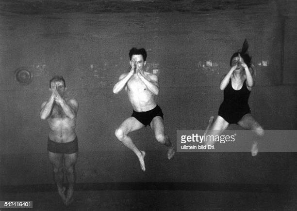 Germany Berlin training of highperformance sportsmen in the German Reich picture of three swimmers under water taken through the submarine...