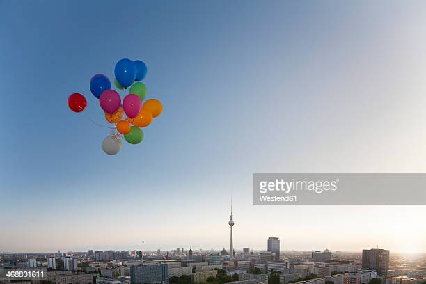 Germany, Berlin, View over city from rooftop terrace with balloons