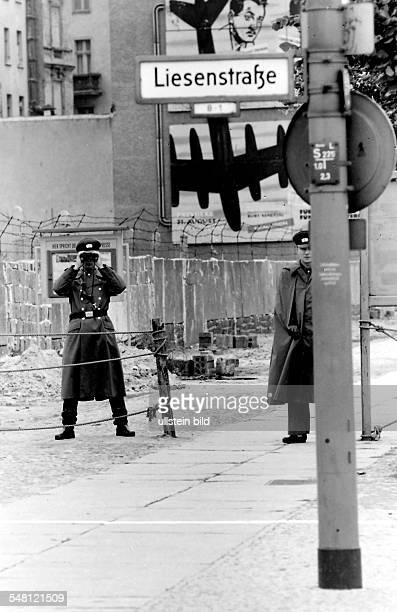 Germany Berlin Wedding building of the wall east German policemen watching the border at Liesenstrasse corner to Chausseestrasse August 1961