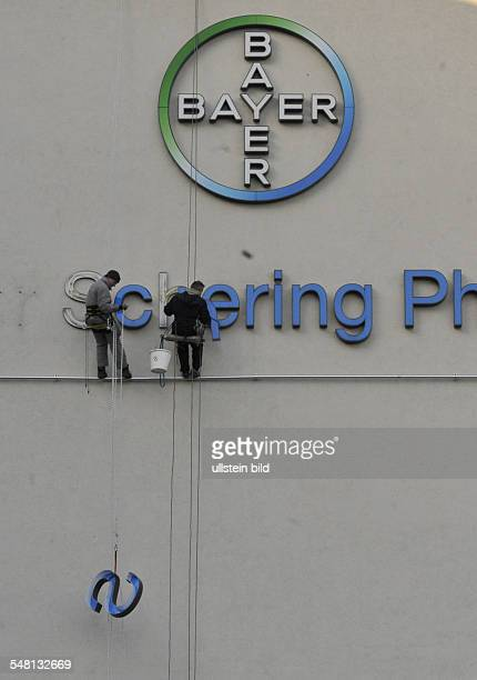 Germany Berlin Wedding removing the lettering Schering from the front of the Berlin headquarters at Muellerstrasse now Bayer AG