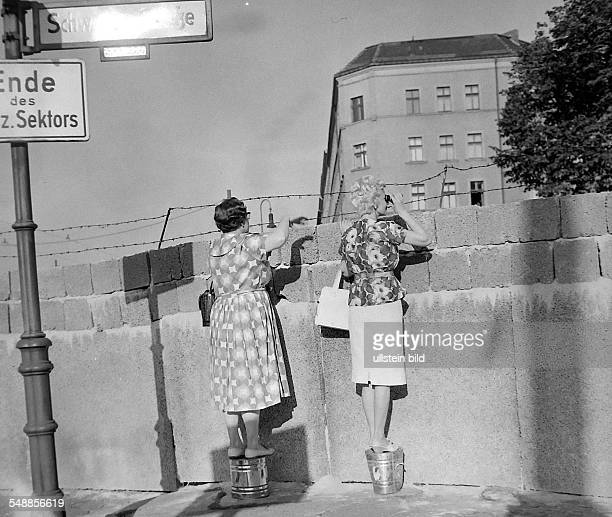 Germany Berlin Wedding two women looking over the Berlin wall at Schwedter Strasse