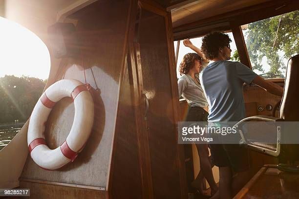 Germany, Berlin, Young couple in boat cabin, life belt in foreground