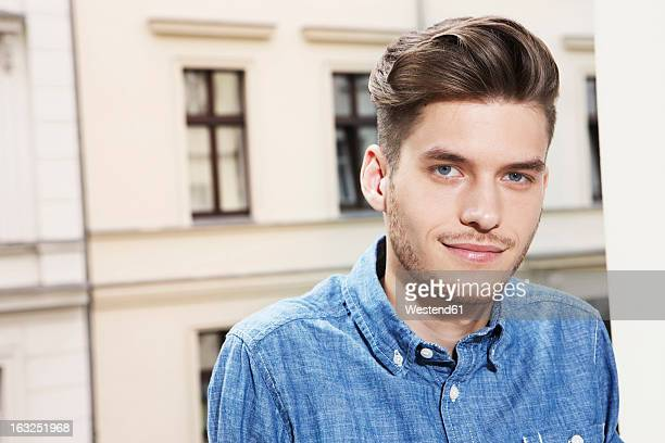Germany, Berlin, Young man smiling, portrait