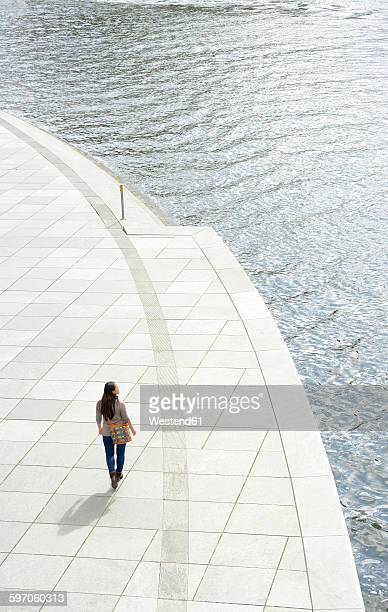 Germany, Berlin, young woman at river Spree