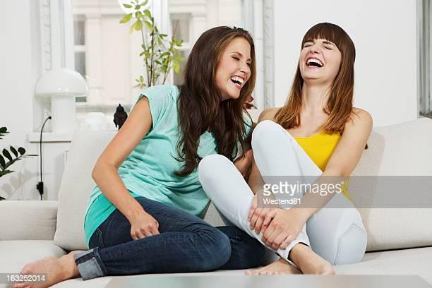 Germany, Berlin, Young women having fun, smiling