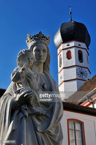 Germany, Beuerberg, Statue of Virgin Mary with child Jesus in front of monastery