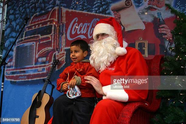 GER Germany Bonn Little boy sitting on Santa Claus legs