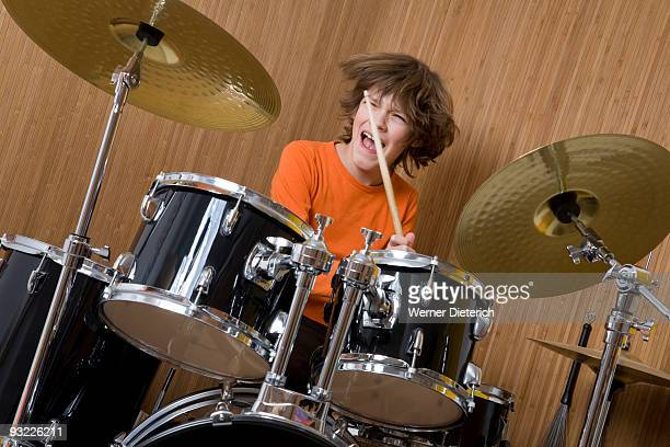 Germany, Boy (12-13) playing drums