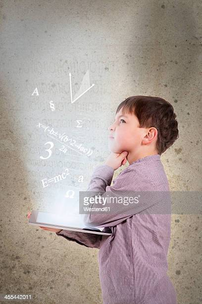 Germany, Brandenburg, Boy thinking with digital tablet
