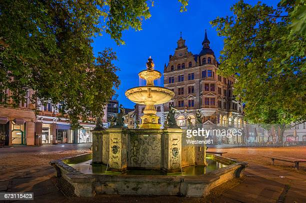 Germany, Braunschweig, Kohlmarkt fountain in the evening