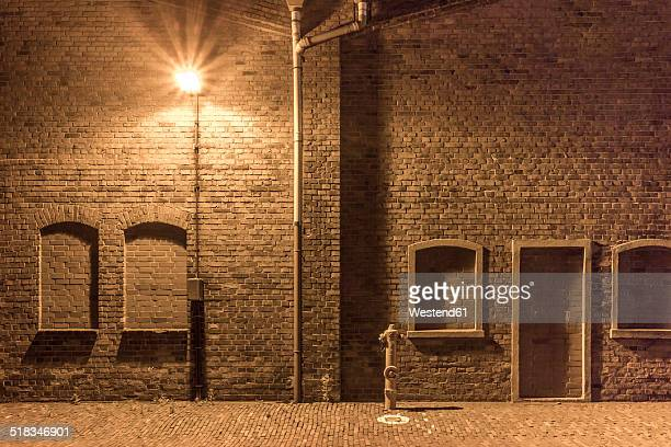 Germany, Bremen, A hydrant and a street lamp in an abandoned industrial district
